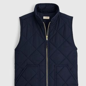 New J Crew navy vest with gold detail.